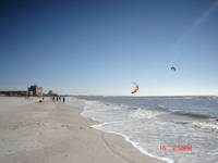Men flying kites to surf the waters on St. Pete Beach near Dolphin Beach Resort/ mid January 2005 Gulf of Mexico.